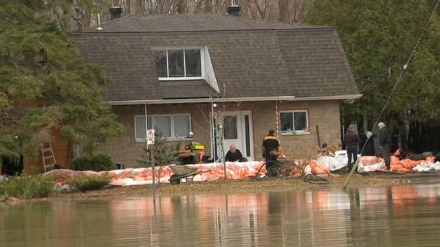 Residents rush to protect their properties as spring floods threaten homes in Canada