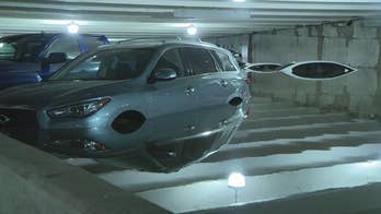 Heavy rain wreaks havoc on Dallas airport parking lot