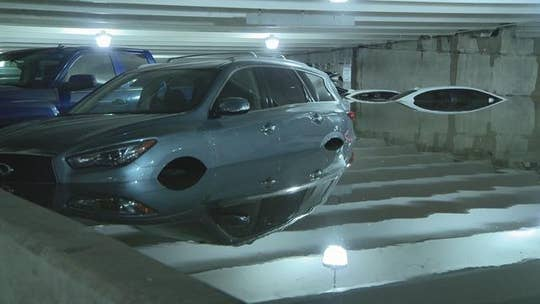 Heavy rain wreaks havoc on Dallas airport parking lot