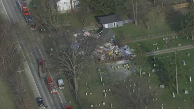 Raw video: Crews survey a site where a tractor trailer collided with a pickup truck then  smashed into a house