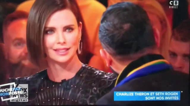 Charlize Theron scolds French TV host for kissing female interpreter: 'Ask next time'