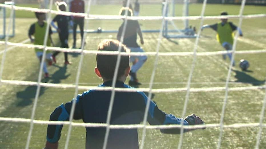 The booming business of youth sports leaves some opportunities out of reach for kids of working families