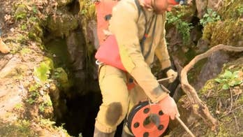 Crews rescue five men from a Virginia cave after heavy rains trapped them inside