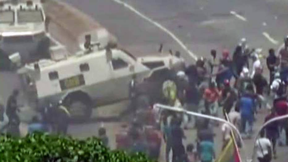 Warning, graphic video: Government vehicle runs over protesters in Venezuela