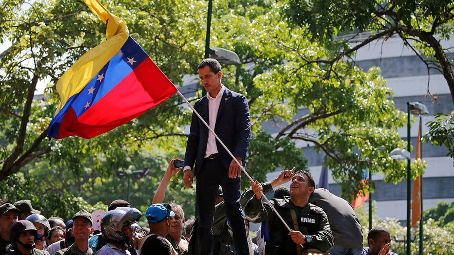 Clashes continue in Venezuela as US backs Guaido's calls for liberation
