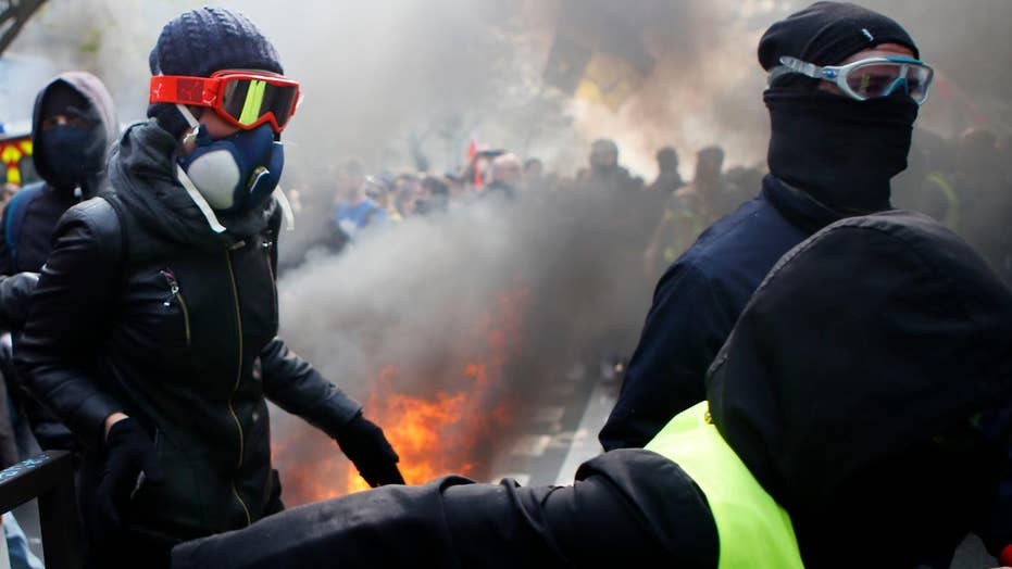 May Day protests turn violent in France as police clash with rioters