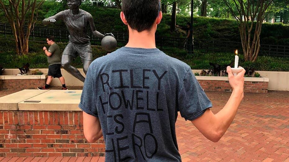Student who tackled gunman, saved lives is honored at vigil