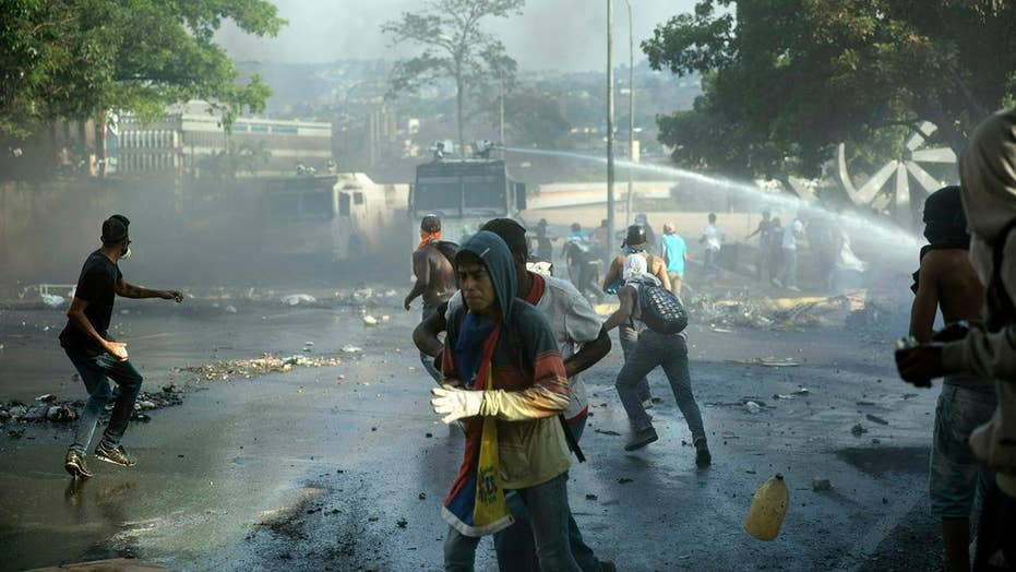 Reporter injured during violent protests on the ground in Venezuela
