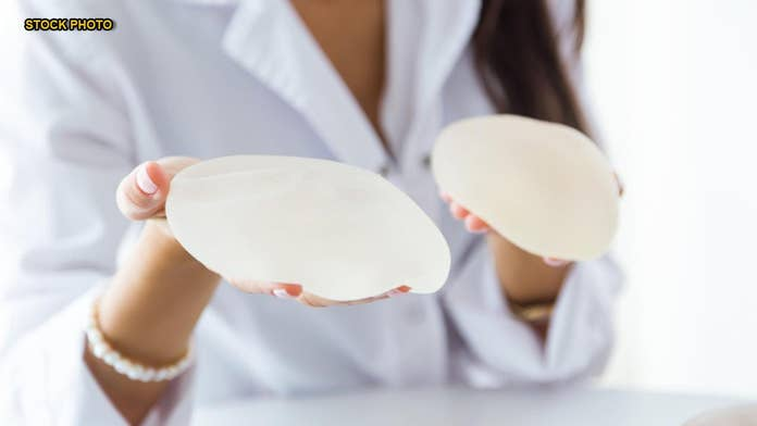 Breast implants linked to rare form of cancer, but FDA declines to ban
