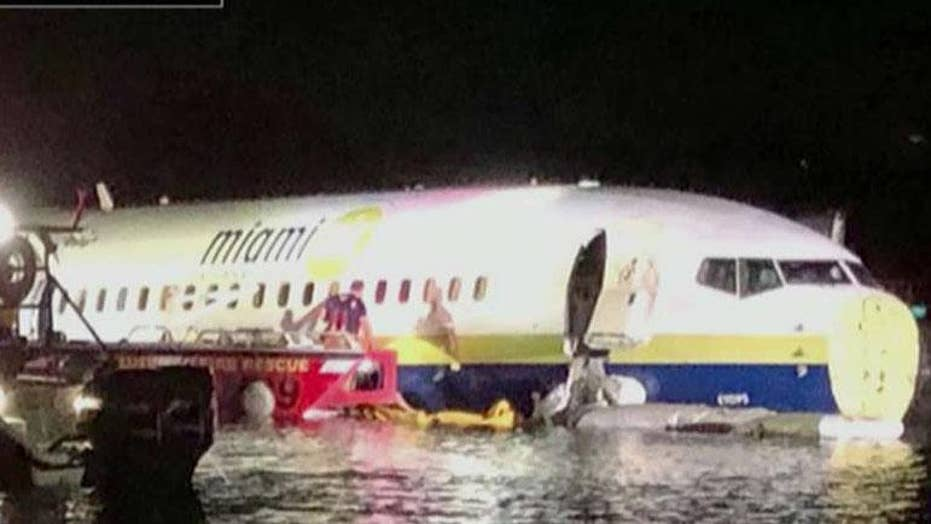 Boeing 737 slides off runway and into river in Jacksonville, Florida