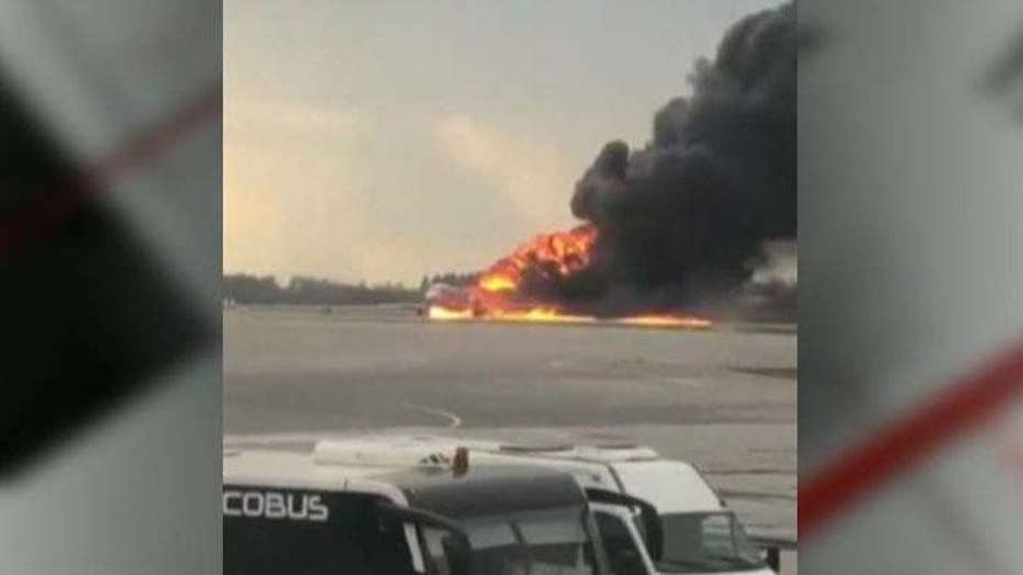Plane lands in flames in Russia