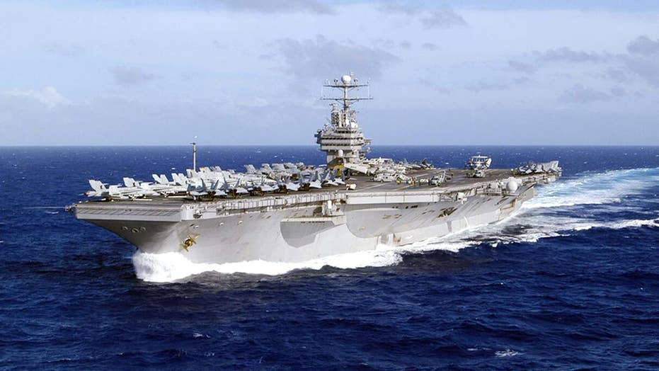 US deploys strike group to send 'clear and unmistakable' message to Iran