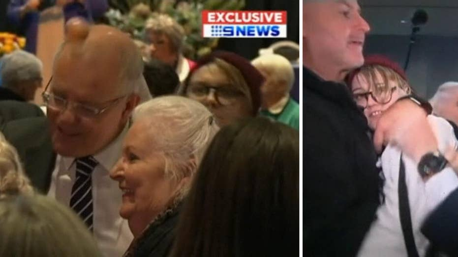 Australian prime minister attacked with egg by protester at election event