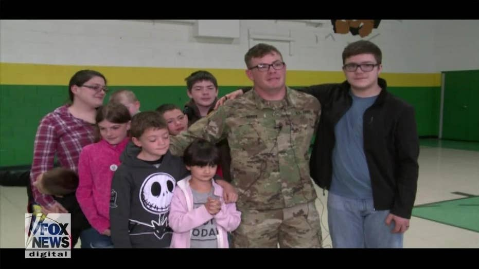Soldier surprises his kids at school with early homecoming
