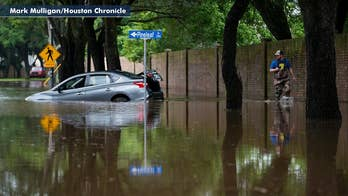 Texas communities under water after a foot of rain hammers state