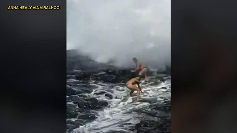 Tourists knocked over by wave in Hawaii while trying to get 'perfect shot'