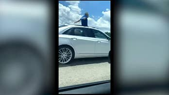 Florida man stands in sunroof while driving