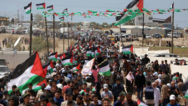 Bloody day on Gaza border as thousands of Palestinians protest on Nakba Day