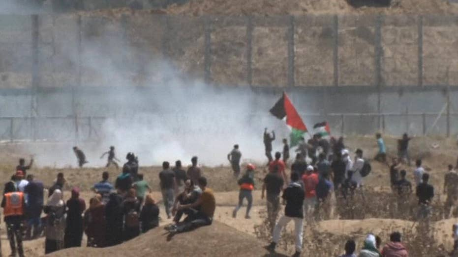 Thousands of Palestinians protest at the Israel border to mark Nakba