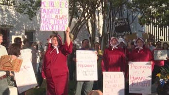 Alabama abortion advocates promise to fight back after controversial bill signed into law