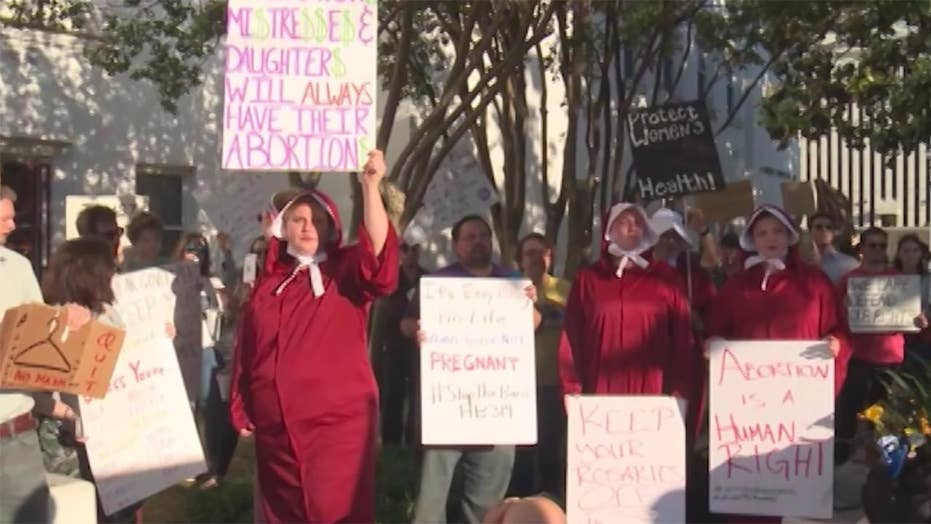 Alabama abortion advocates vow to fight abortion ban