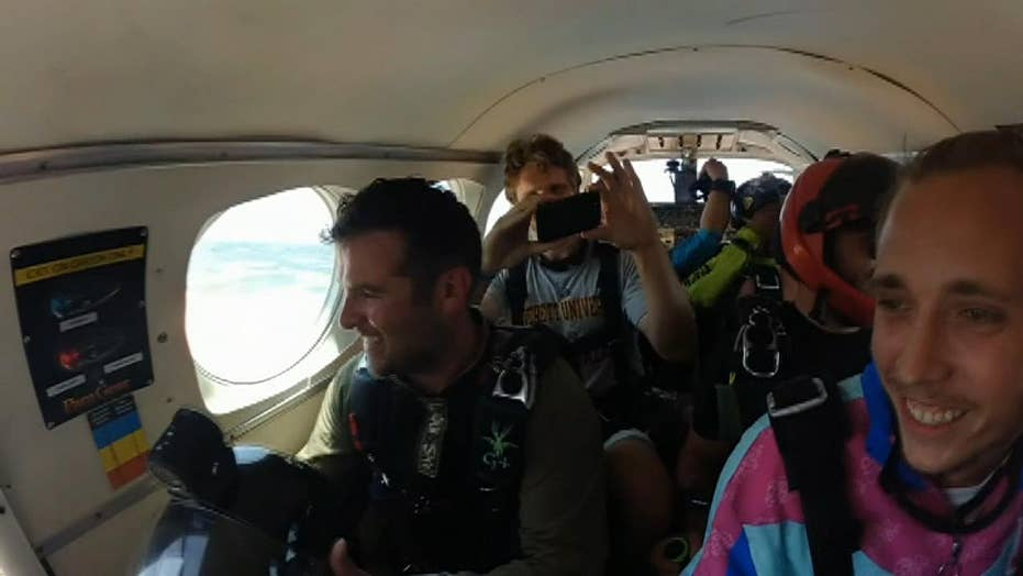Family stages skydiving gender reveal