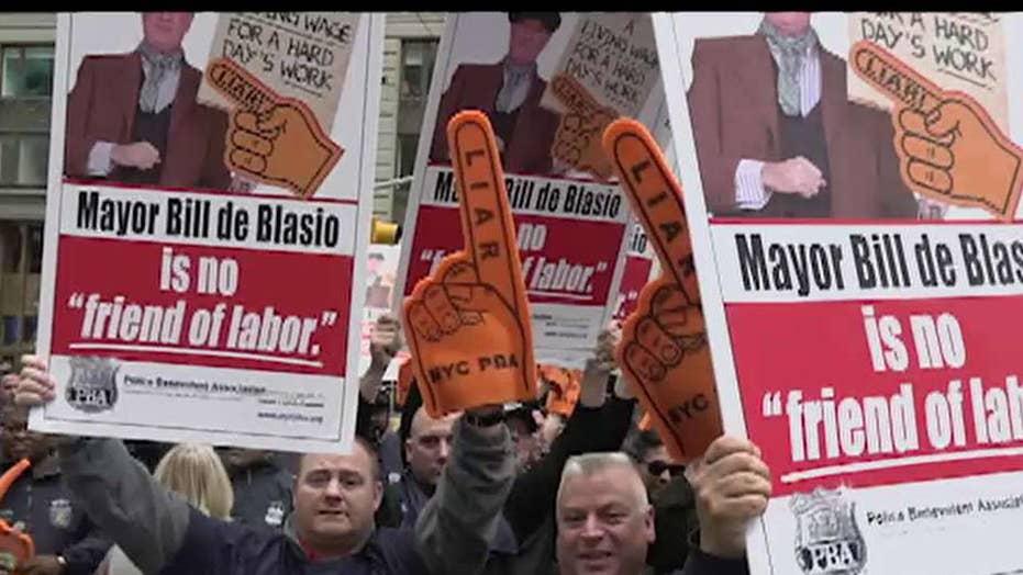 NYC Mayor Bill De Blasio faces protesters after announcing 2020 presidential bid