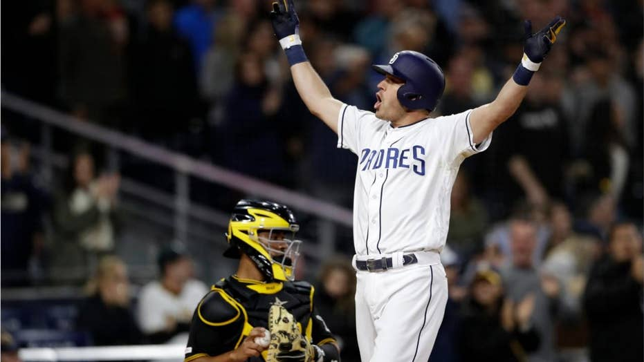 San Diego Padres' Ian Kinsler appears to scream 'f--- we all' during throng after home run