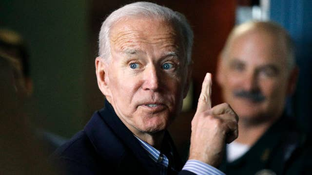 Sen. Chris Coons shows his support for Joe Biden at a campaign rally in Philadelphia, Pennsylvania