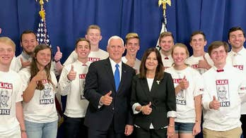 Vice President Mike Pence is met with protests and applause at Taylor University
