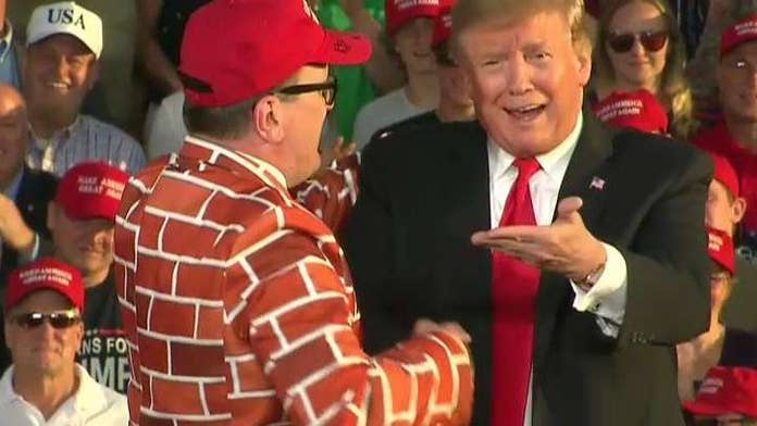 Trump invites supporter wearing wall suit to Pennsylvania rally stage