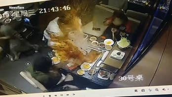 Horrifying footage shows boiling soup exploding in waitress' face at hot pot restaurant