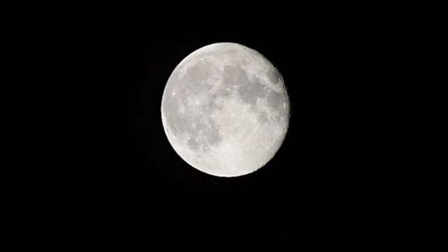 A new study suggests that a 'large body' crashed into the Moon and gave it its distinctive features
