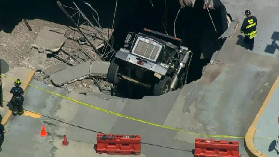 Raw video: Officials cordon off hole where a truck has fallen through the roof of a parking structure