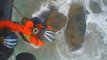 Coast Guard saves couple trapped by rising tide and battered by waves on Oregon shoreline