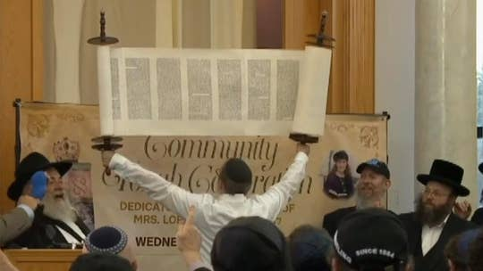 Woman slain in California synagogue attack honored with Torah scroll