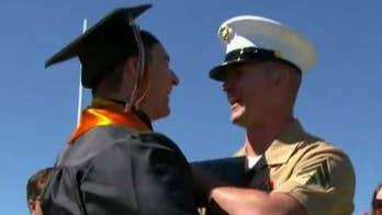 US Marine surprises brother at high school graduation by presenting his diploma