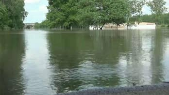Arkansas residents forced to flee their homes amid historic flooding