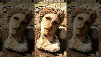 Ancient marble head depicting the Greek god Dionysus discovered in Rome