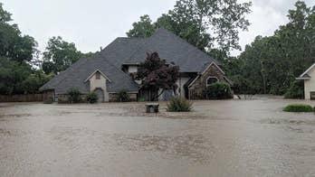 Arkansas residents assess flood damage after massive storms