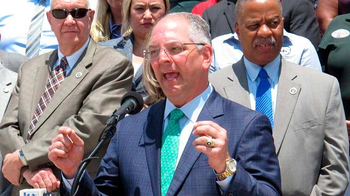 Democratic Louisiana governor defies party, plans to sign strict abortion ban into law