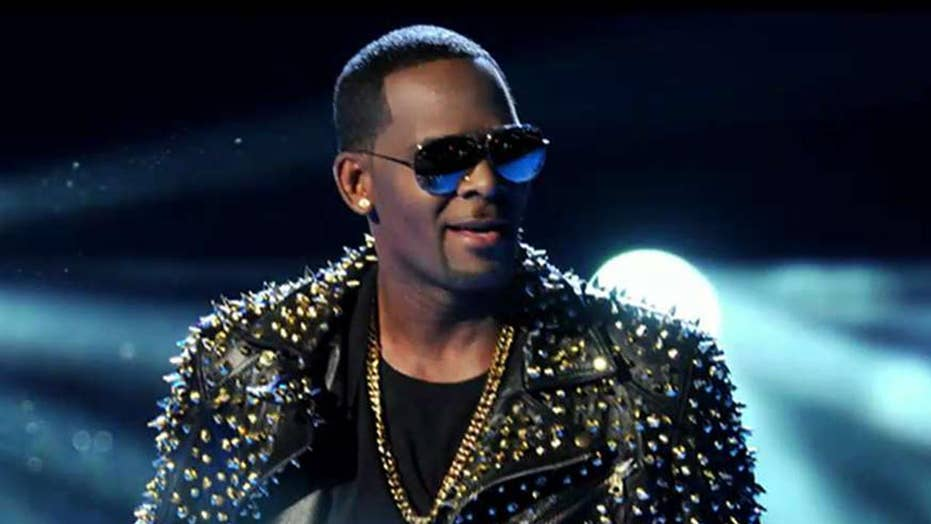 R. Kelly charged with 11 new sex-related counts