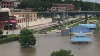 National Guard works to redirect floodwaters after Arkansas River breaches levee