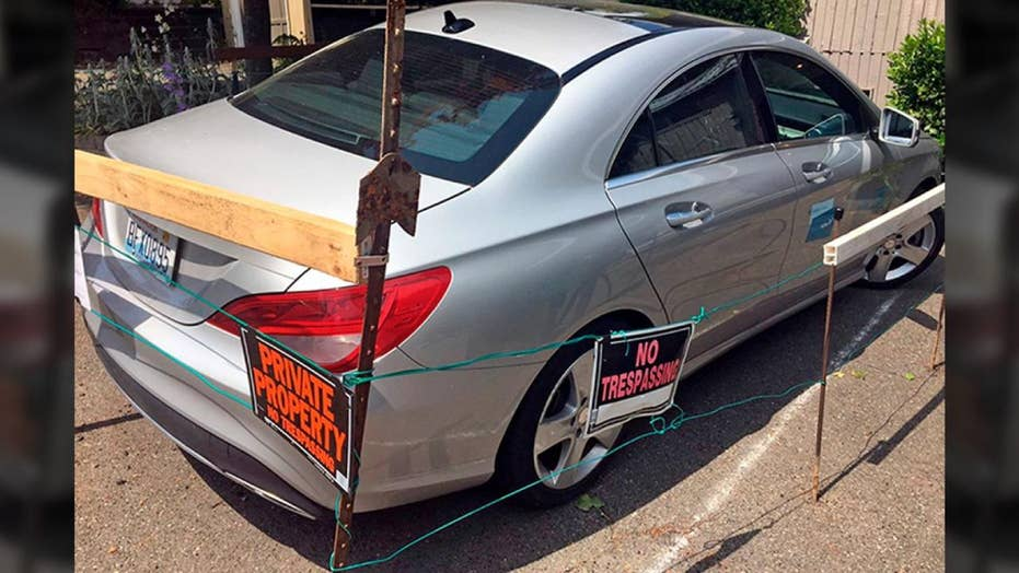 Seattle man builds fence around illegally parked car-share vehicle on property; demands payment