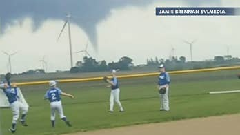 Stunning video shows Iowa Little Leaguers warming up for game as tornado approaches