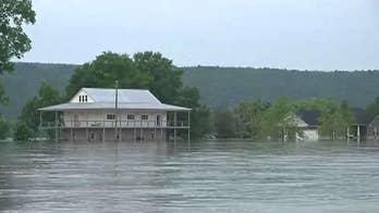 Forecasters predict more rain amid historic flooding along Arkansas River