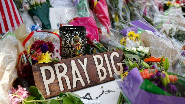 Virginia Beach shooting memorial grows larger by the hour as police probe shooter's motives