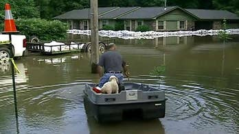 Arkansas braces for more flooding as high water moves south with more rain in the forecast