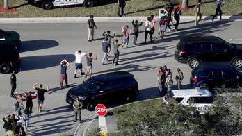 Former sheriff's deputy arrested over deadly school shooting in Parkland, Florida