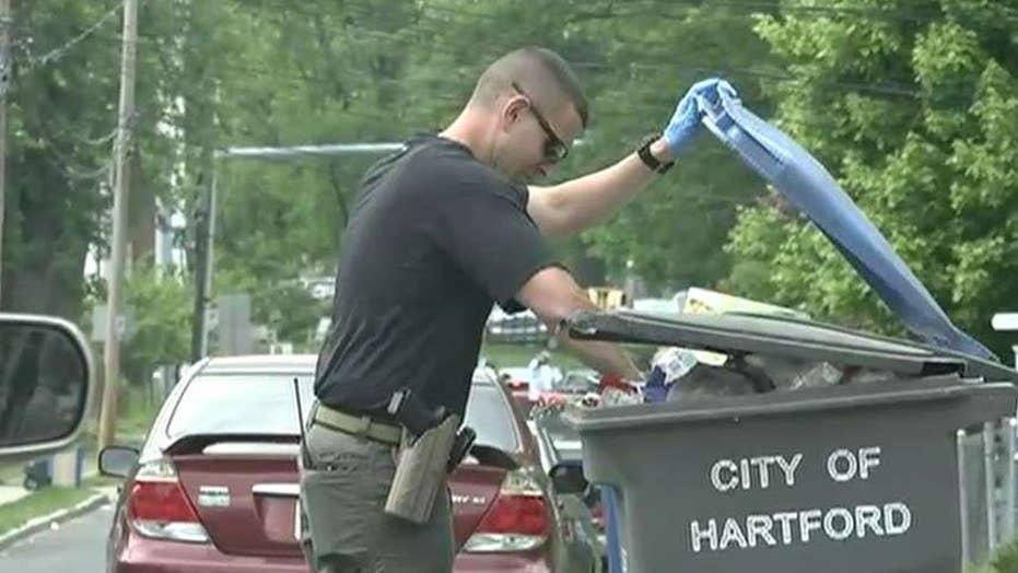 Connecticut investigators seen sifting through Hartford waste facility